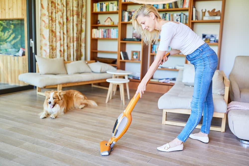 Woman vacuuming home