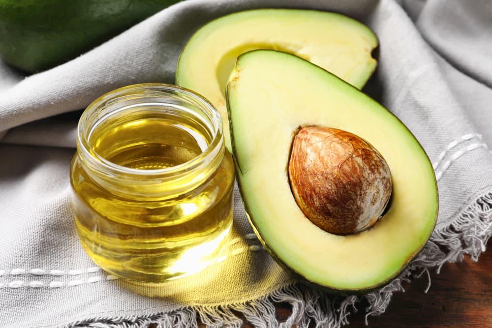 Avocado and avocado oil on a cloth