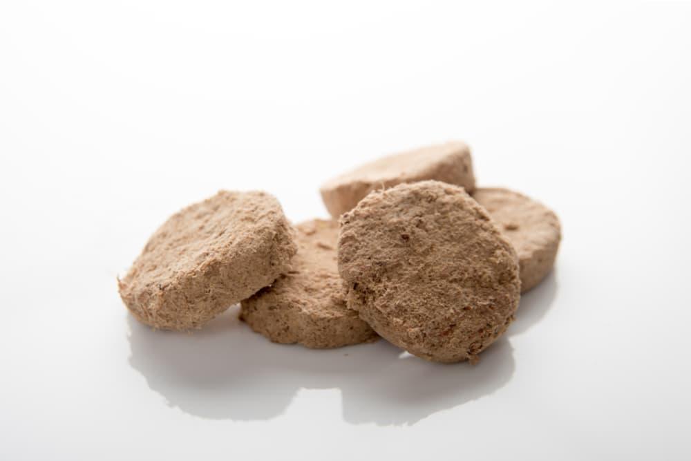 Close up of freeze-dried dog food pellets