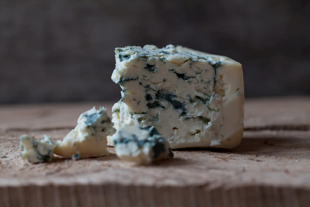 Blue cheese on a wooden table