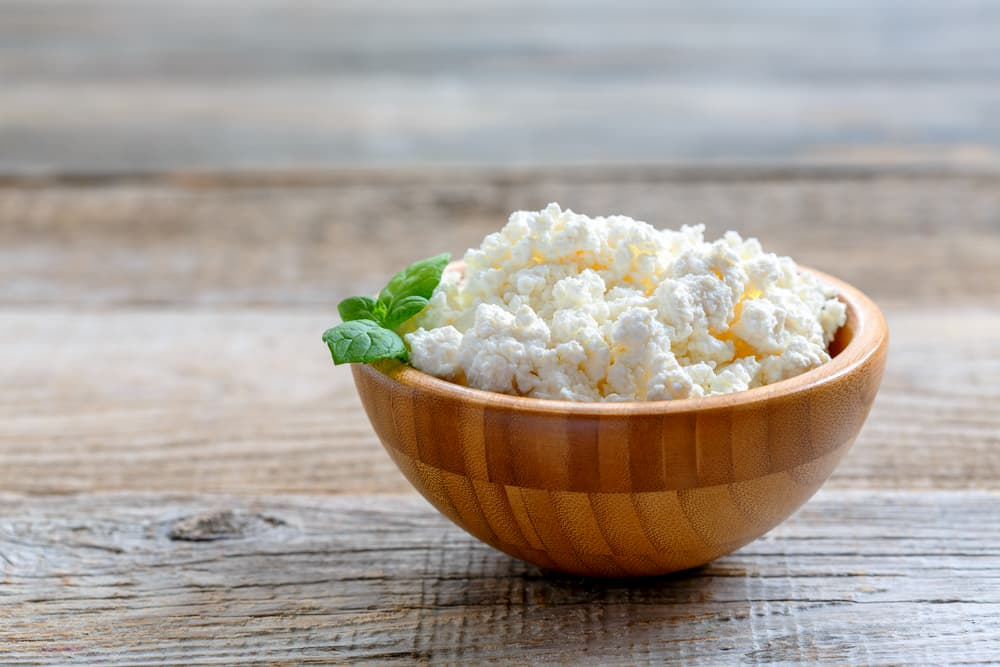 Cottage cheese in a bowl on a table