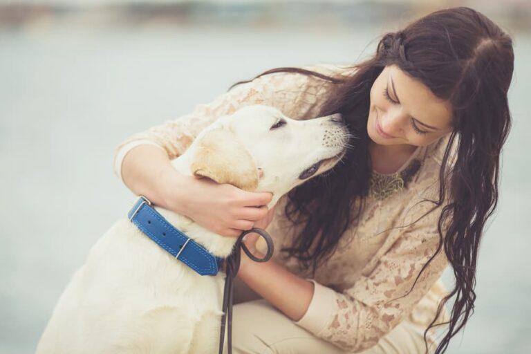woman hugging dog