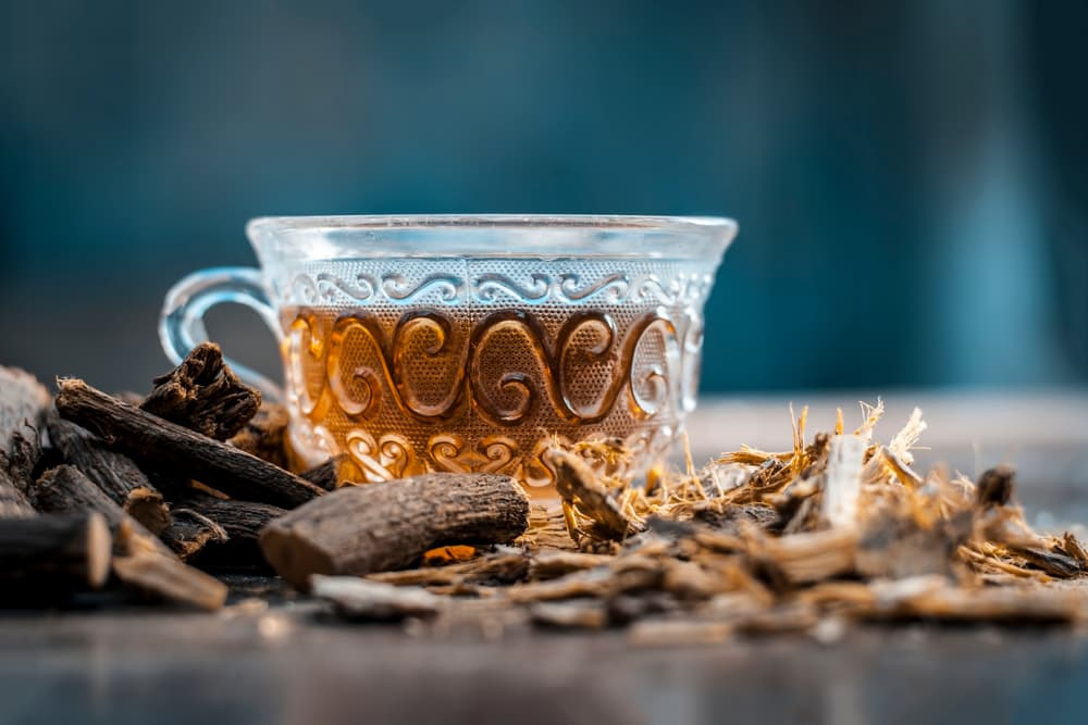 Licorice root branch and tea on table
