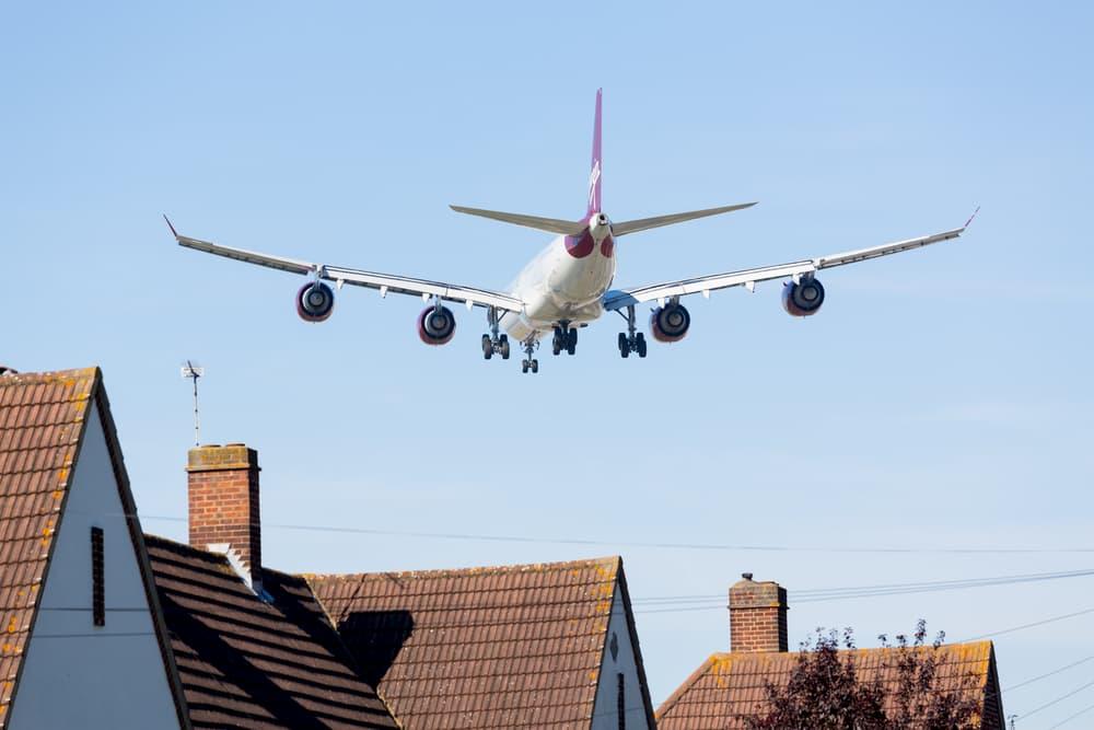 Plane landing near homes