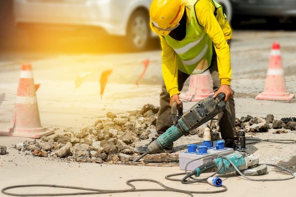 Jackhammering construction worker in the street