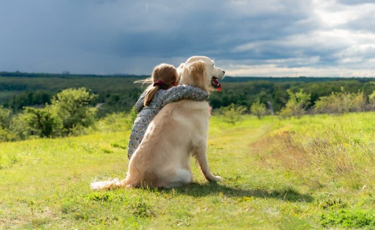 woman with arm around dog