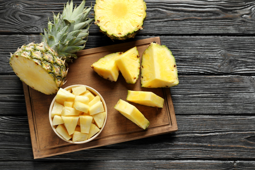 Fresh pineapple on cutting board