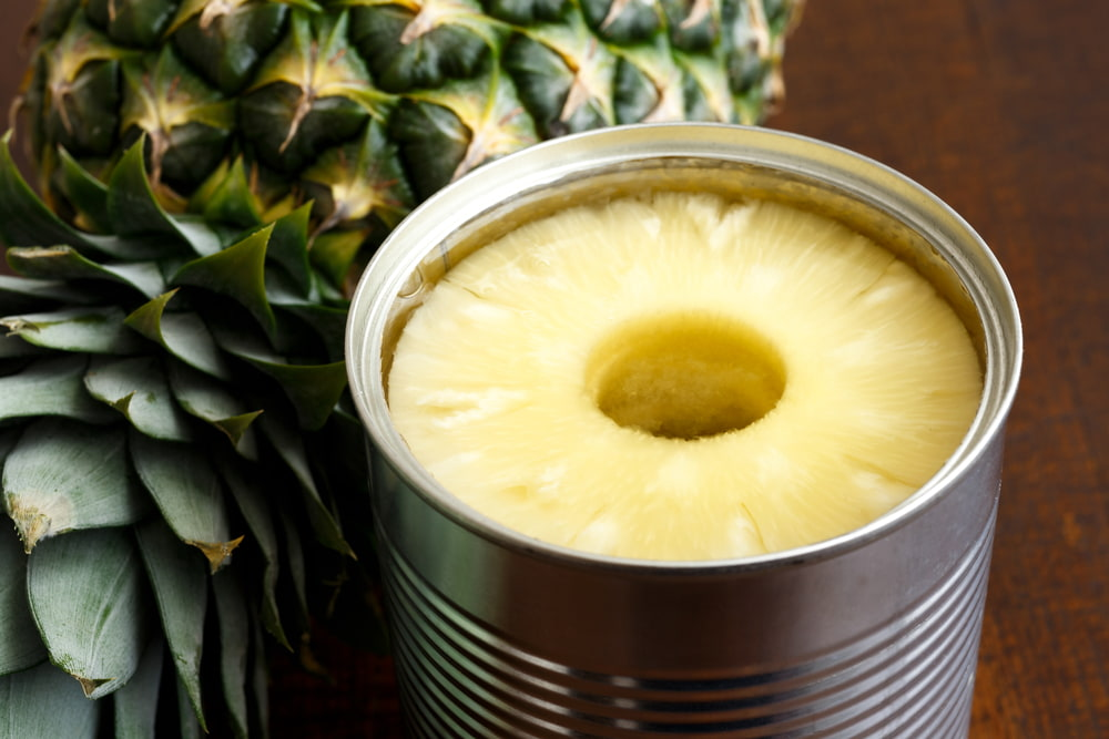 canned pineapple on table