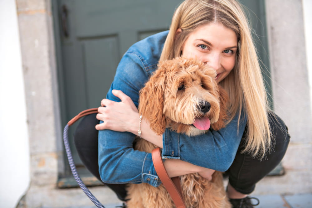Woman with adopted Labradoodle