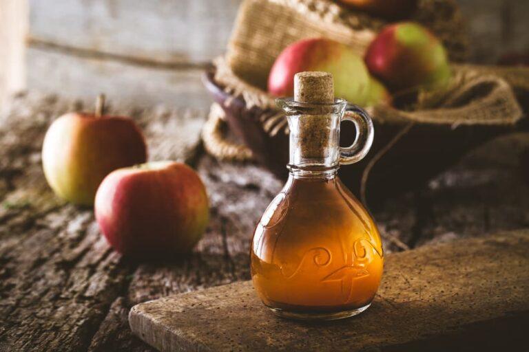 Apple cider vinegar on table