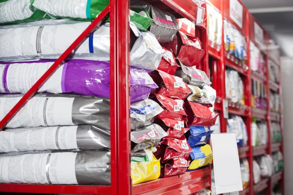 Bags of dog food on shelf