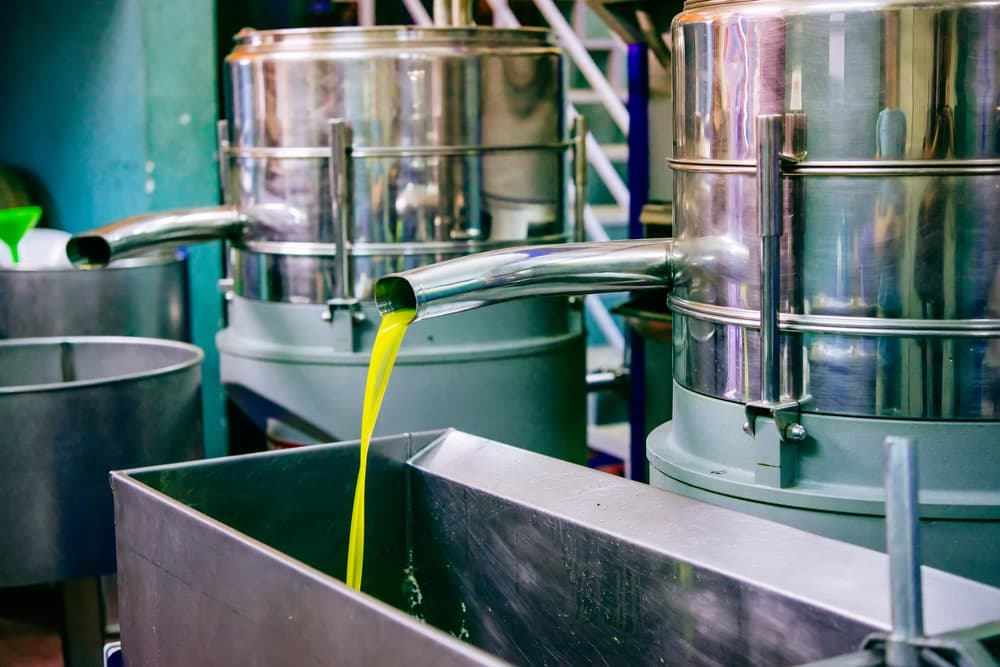 Oil being cold pressed as part of manufacturing process