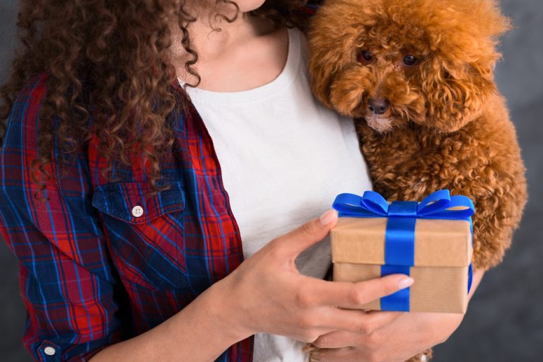 Lady holding present and her dog