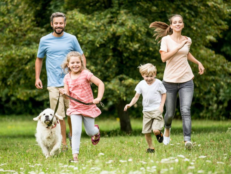 Family outside having fun with dog